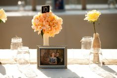I love the idea of decorating each table with a framed picture from your engagement photo shoot.