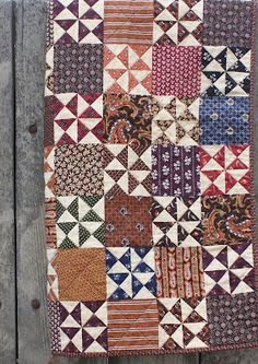 From Temecula Quilt Co. I like the simple blocks best, as they show off the fabric to great advantage.