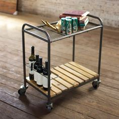 Cute cocktail bar on wheels!! Load it up with drinks down below and glassware up top. Add a plate of cheese for extra impact.