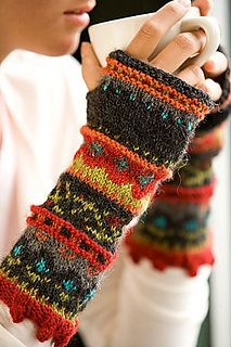 Summary: Fingerless mittens with gussetted thumb, knit in six colors in varying stranded colorwork patterns in stockinette, with bobbles, ribbing, and garter stitch rows thrown in.