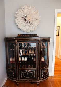 Now this is clever design. Maybe originally created to display crystal glasses and china tea sets. But WOW - put your shoes on display.... lets get our priorities right.