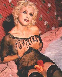 Pictures of Madonna by Bettina Rheims used for the promotion of her 1994 Human Nature Single