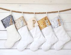 Monogrammed tags with the initials of each member in your household jazz up glitter-flecked stockings.