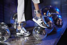 Women's sneakers that bring the party with a disco ball front and centre, bunny ear logo and detachable mirrored ankle strap. Emblazoned at the heel with a call to action - as if you needed the memo!