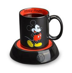 Disney Mickey Mug Warmer  Disney Mickey Mug Warmer with Ceramic Mug Keeps Hot Beverages and Soups Warm and Includes 10 oz. Ceramic Mug. It can be used with other mugs that are flat on the bottom. It uses 110V. The mug is both microwave and dishwasher safe. There is a power off/on button that lights up when turned on.