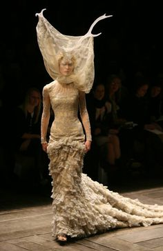Alexander McQueen from THAT show. Apparently the torn lace was a mistake when they were mounting the headress. It worked AMAZINGLY!!!!