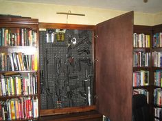 Hidden Gun Storage   Secret Gun Compartment in Office/Library Secret Gun Compartment in ...  Thought @Brittany Horton Lawson might like this :p