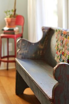 Repurposed church pew. Love the chair in the background too!