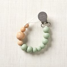 Sale ends soon. Shop Loulou Lollipop Sage Green Silicone and Wood Pacifier Clip. The Loulou Lollipop Sage Green Silicone and Wood Pacifier Clip makes teething easier for babies and parents alike. Best Baby Shower Gifts, Baby Gifts, Baby Presents, Teething Toys, Baby Teething, And Just Like That, Crate And Barrel, Baby Toys, Kids Toys