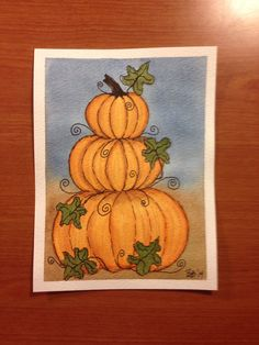 Stacked pumpkins and curly-q's in watercolor and ink.
