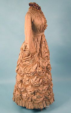 Silk Festooned Bustle Dress, 1878 With Acknowledgement to Ashley Taylor, who has created one of the most beautiful pages on this entire site. If you don't check her work, you are really missing something extraordinary, spectacular, and exquisite.