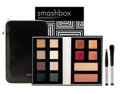 Smashbox's new Mod Chic Holiday 2006 Collection...Beauty A-Go-Go Color Palette and Brush Kit...This kit contains eight eye shadows, four lip glosses, two multipurpose highlighters, and two mini houndstooth brushes. It all comes in a cute black and white patent-leather pouch that is perfect for traveling, or just to stick in your purse! The thing I love about this kit is its range in colors–it is great to put on a natural look for the day, as well as a glammed out look for the night!