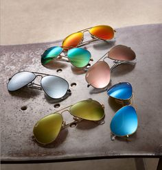 Ray-Ban: Classic aviator frames with flash mirror colour lenses. $200 each. #holtsmag ...... Hmmm, now to decide which color.