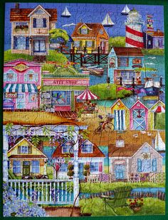 """Pastime puzzles. """"Village by the Sea"""" by artist Nancy E. Mink. 500 pieces, including shaped pieces (""""whimsies"""")"""