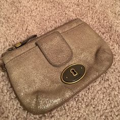 Fossil Coin Purse A little worn on corners and on the zipper but still in wonderful shape! A gold glimmer color. Front snaps for change or small items and inside zips and can hold cards (on the side) and other items. True fossil brand. Clean inside. Corners show small wear and zipper. Fossil Bags Wallets