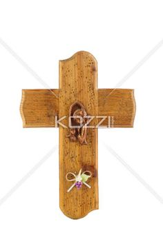 cross displayed on white. - Close-up shot of a cross displayed on white background.