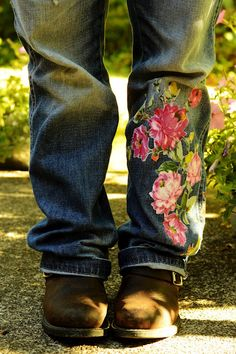 Embellish a pair of jeans by applying a cut out from a vintage bed sheet