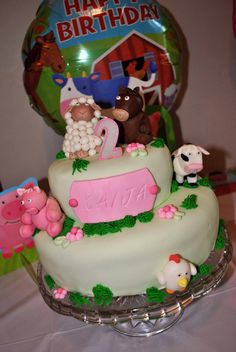 Farm barnyard cake girl 2nd Birthday marshmallow fondant pig chicken horse cow sheep green pink cute top layer Rice Krispie  covered icing and fondant