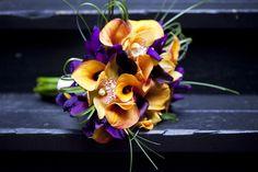 Orange calla lillies, purple irises, and orchids