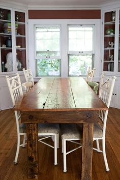 Love this rustic table with the mix-matched chairs.  (Beautiful built-ins don't hurt!)