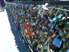 A couple writes their names on a padlock and locks it onto one of the Pont des Arts bridge. They then throw the key into the Seine River as a symbol of their undying love. One day, I'll do this.