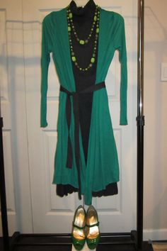 Brighten black with bright green long cardigan and pumps.