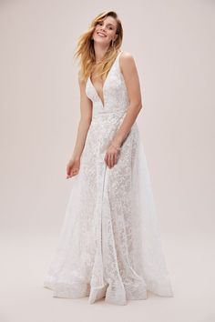 A sultry and eye-catching lace sheath wedding dress with a plunging illusion neckline and double spaghetti straps. Available in Sydney, Melbourne & Online. Wedding Styles, Wedding Ideas, Farm Wedding, Wedding Couples, Boho Wedding, Wedding Reception, Indian Wedding Outfits, Wedding Dresses, Sherwani Groom