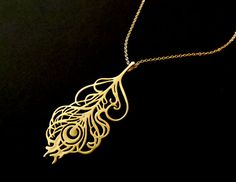Gold peacock feather pendant necklace