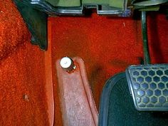 The high beam and dimmer switch was somewhere on the left side of the floor near the brakes.