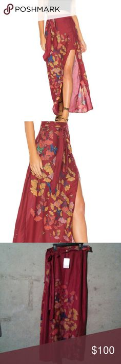 Free People Faux wrap skirt Tag size Sz 12 (Large). NWT. Soft and lightweight maxi featuring floral and butterfly print. Side slit detailing and an adjustable waist belt. faux wrap styling, lined with a half slip. Free People Skirts Maxi