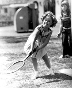 Shirley Temple playing tennis, 1935.