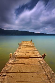 Lake Beratan, Bedugul, Bali, Indonesia This place it looks like you can walk out on this dock and look all around you at all the beauty and all your problems and stress will melt away!