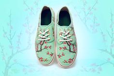 Stand out the next time you step out in your new AriZona Green Tea Sneakers! With the bright and bold fan favorite cherry blossom design you're sure to get noticed no matter where you're going. (Quantities are limited. Men sizes fit true to size/Women sizes are running a size large)