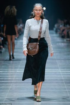 Lou Kenny, 58, walking the catwalk at the Melbourne Fashion Festival 2017 says yoga and oi...