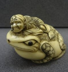 Gama Sennin seated on a giant toad. Japanese netsuke, Ivory, the toads eyes inlaid with ebony, made by Masakazu 正一, 19thC