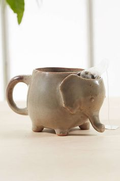 An elephant mug with a built-in compartment to put your tea bag in.