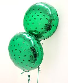 Use a black marker pen to turn ordinary green balloons into cactus balloons! These are perfect summer party decorations (whether you're throwing a whole cactus themed party, Mexican fiesta or otherwise!)