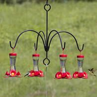 Umbrella Quad Bracket for Hummingbird Feeders. if you cant find that, place a post in the ground. Secure planter to top of post. Attach four hooks then hang feeders. - My Gardening Path Garden Yard Ideas, Lawn And Garden, Garden Projects, Humming Bird Feeders, Humming Birds, Humming Bird Bath, Hummingbird Garden, Backyard Birds, Plantation