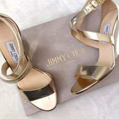 NIB Jimmy Choo Gold Wedge Sandal These are absolute perfection! (I mean, they are JCs after all!) The mirror finish wedge and bright gold leather are a pop of gorgeous every outfit is asking for! No flaws, ship in original box. Jimmy Choo Shoes