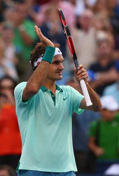 TORONTO, ON - AUGUST 04: Roger Federer of Switzerland reacts after defeating Peter Polansky of Canada during Rogers Cup at Rexall Centre at York University on August 5, 2014 in Toronto, Canada. (Photo by Ronald Martinez/Getty Images)