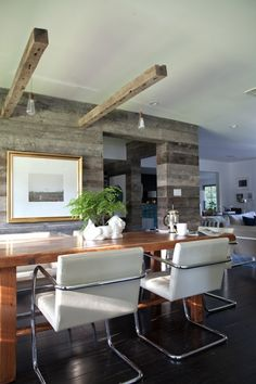 This blog page has amazing modern rustic pictures!  Our formal dining room doesn't have overhead lighting.  Hiding the wiring in the beams is a great way to get light without having to rewire the entire room which would be difficult according to hubs because of the way the joists run.