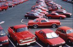 """CarPark by Nina Katchadourian, """"Public art work where thousands of cars were parked by color for half a day"""" (1994)."""