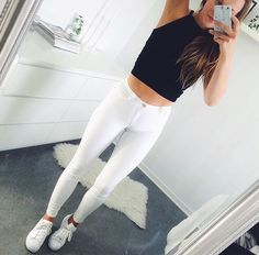 White Skinny Jeans, Black Halter Neck Crop Top And White Trainers
