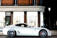 Oooh, gotta love white classy cars;)