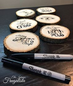 DIY+Wood+Slice+Holiday+Coasters Using carbon paper I simply traced the graphics over each wood slice. diy wood slice holiday coasters, christmas decorations, crafts, seasonal holiday decor, woodworking projects Using a Fine and Ultra Fine Black Sharpie Marker I filled in the pencil marks. After letting the ink dry overnight, I sprayed two coats of Shellac to protect each coaster. I also added felt feet on the bottom of each to protect table top surfaces.