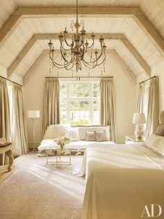 A whitewashed-oak ceiling caps the master bedroom of this Atlanta home devised by Suzanne Kasler Interiors and William T. Baker & Assoc. Read on for more beautiful vaulted ceilings.