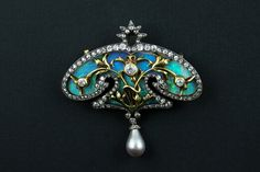 An Art Nouveau silver topped yellow gold diamond and opal brooch with a natural grey pearl.  France, 1900 c.a. Pennisi Milano