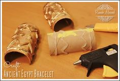 Art Smart Jr/Sr - Ancient Art - Egyptian Bracelet - Toilet paper roll, white glue or glue gun painted over with metallic acrylic. Ancient Egypt Crafts, Egyptian Crafts, Egyptian Party, Egyptian Jewelry, Egyptian Diy Costume, Ancient Aliens, Pharoah Costume, Armband Diy, Cleopatra Costume