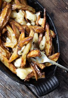 Authentic Canadian Poutine Recipe - be ready for Canada Day with fries, gravy and cheese curds!
