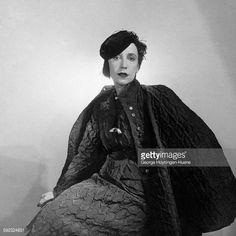 Mme. Schiaparelli, French designer, wearing taffeta dinner suit by Schiaparelli. Vogue 1933